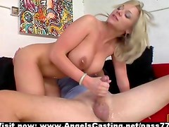 Busty naked blonde with nipple piercings riding cock on couch
