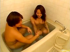 Gorgeous Asian MILF Giving a Great Blowjob In The Bathtub