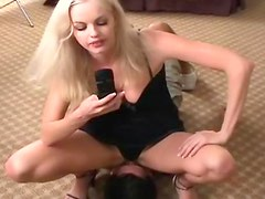 Blonde in black panties sits on his face
