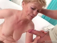 Hairy granny gets fingered then sucks dong
