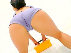Busty constructor thrusting dildo in her ass