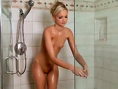 Slim But Sexy Blonde Takes A Shower While Fingering Her Wet Pussy
