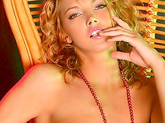 Curly hair blonde poses nude