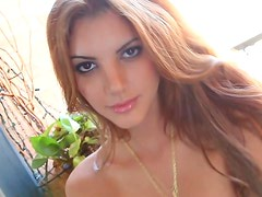 Redhead with gorgeous eyes teases solo