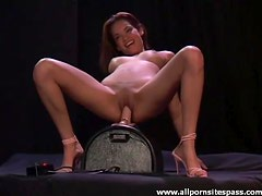 Pink heels on hottie that rides a toy