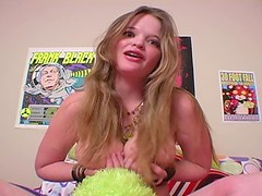 Voluptuous girl in braces talks and fondles her tits