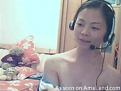 Asian babe strips for her BF on the webcam