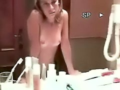Girlfriend caresses his cock in bathroom