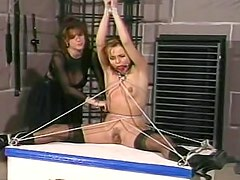 Sexy dungeon play with corseted girl