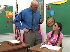Teen and teacher screw in the classroom