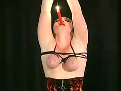 Bound tits with hot wax dripping on them