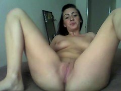She models her pussy and plays with her clit