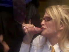 Corporate chick sucks off cocks in elevator