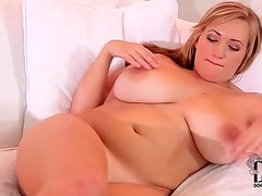 Cute chubby girl on the couch fondles tits