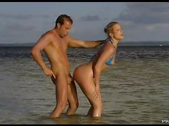 Horny Blonde Blows A Big Cock Outdoors On The Beach