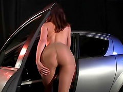 Classy girl poses by a hot car