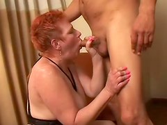 Redhead and bewitching Susan is licking huge balls