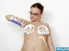 Amateur girl with glasses likes a milk shower