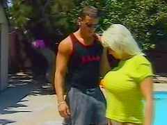 Busty and hot milf is satisfying her bf outdoors