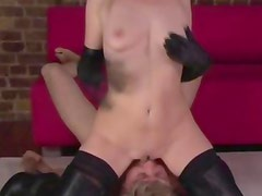 Hot blonde in leather getting oral from her subject