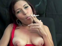 Heavy smoker with big lips and natural tits is smoking cigarette