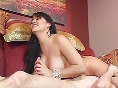 Curvy beauty with nice perky tits gives guy a hand job