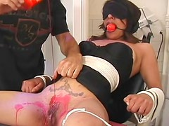 Dungeon babe in bondage and pain