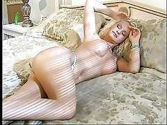 Mature blonde babe fingers and tastes her wet pussy
