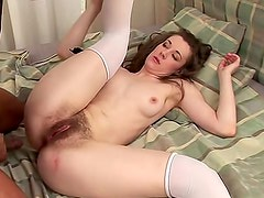 Sexy and nude doll Lia Rav in white stockings is riding on big schlong indoors