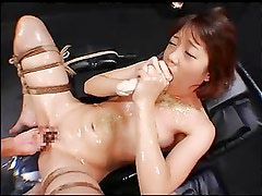 Asian whore gagging on a dildo