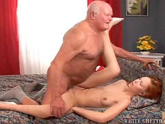 Sexy Redhead Gives A Christmas Surprise To A Horny Old Guy