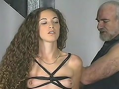 Curly hair beauty in sexy bondage