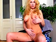 Toothy grin blonde girl displays her body