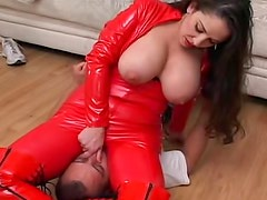 Leather catsuit girl sits on his face
