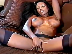 Black milf with fake tits teases us