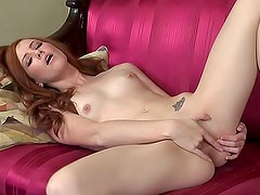 Redhead solo girl with sexy body is satisfying her shaved pussy indoors