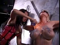 Ebony Dominatrix Abusing Big Boobed Blonde