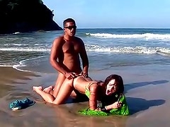Lady on the beach fucked in the ass