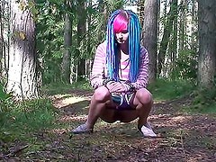 Punk teen takes a piss in the woods