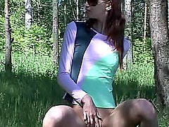 Hottie pisses on a log outdoors