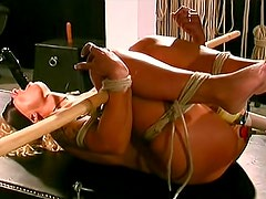 Wide hips blonde girl in sexy bondage