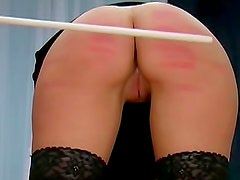She whimpers during an ass caning