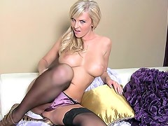 Sexy baroness Chikita with fake tits is rubbing her kitty