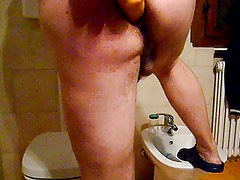 streching ass. dildo and beer bottle. comment please