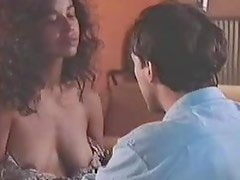 Sexy Ebony Celeb Rae Dawn Chong Shows Her Juicy Rack in a Hot Scene