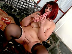 Fat redhead banging cunt with dildo