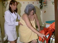 Bath for gray haired granny from nurse