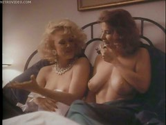 Busty Shannon Whirry Laying Naked in a Bed With Another Hot Girl