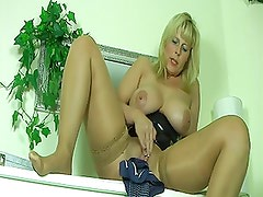 German in tan stockings masturbates and comes and squirts