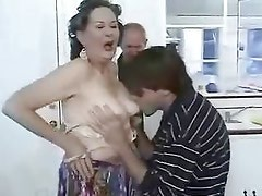 Oma paying with young cock